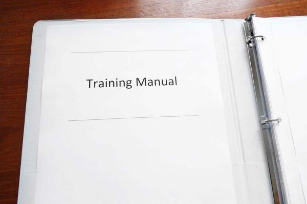 Training manual in a three ring binder