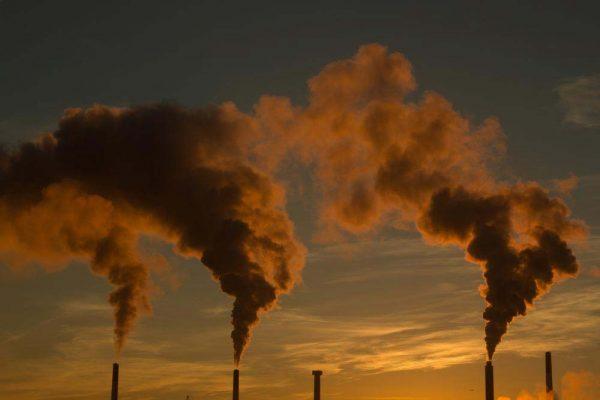 Smoke stacks during sunset