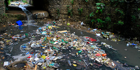 Trash in water in a rainwater channel
